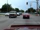 CARS DRIVING THROUGH INTERSECTION, SASKATOON