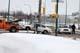 TOW TRUCK PULLING CAR IN WINTER, SASKATOON