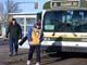 PEOPLE WAITING FOR CITY TRANSIT BUS IN WINTER, SASKATOON