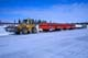 FRONT END LOADER AND SKID TRAIN ON ICE ROAD, INUVIK