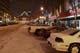 CARS PARKED ON 21ST STREET AT NIGHT IN WINTER, SASKATOON