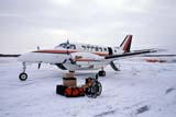 TRA AIR MIS  NT  KJM0105720DMEDICAL SUPPLIES NEAR AKLAK AIR BEECH 99 AIRCRAFT IN WINTERAKLAVIK                            05..© KEVIN MORRIS               ALL RIGHTS RESERVEDAIRPLANES;AKLAVIK;ARCTIC;BEECH_99;DISABILITIES;NORTHWEST;NORTHWEST_TERRITORIES;NT_;NWT;SUPPLIES;TERRITORIES;TRANSPORTATION;TRAVEL;WHEELCHAIRS;WINTERLONE PINE PHOTO            (306) 683-0889