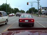 TRA AUT MIS   SK  CWN02D1067D      CAR STOPPED AT TRAFFIC LIGHTSASKATOON                            07/16©CLARENCE W. NORRIS            ALL RIGHTS RESERVEDAUTOS;DRIVING;INTERSECTIONS;LIGHTS;PLAINS;PRAIRIES;SASKATCHEWAN;SASKATOON;SK_;STREETS;TRAFFIC;TRAFFIC_LIGHTS;TRANSPORTATION;URBANLONE PINE PHOTO                  (306) 683-0889