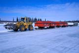 TRA ROA MIS  NT  KJM0104909DFRONT END LOADER AND SKID TRAIN ON ICE ROAD INUVIK                              04..© KEVIN MORRIS              ALL RIGHTS RESERVEDARCTIC;END;EQUIPMENT;FRONT;FRONT_END_LOADER;ICE_ROADS;ICE;INUVIK;LAKES;LOADERS;NORTHWEST;NORTHWEST_TERRITORIES;NT_;NWT;OIL;ROADS;SPRING;SUPPLIES;TERRITORIES;TRANSPORTATION;WINTER;WINTER_ROADSLONE PINE PHOTO           (306) 683-0889