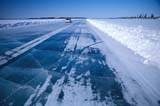 TRA ROA MIS  NT  KJM0105013DVEHICLE ON ICE ROAD, MACKENZIE DELTAINUVIK                              04..© KEVIN MORRIS              ALL RIGHTS RESERVEDARCTIC;ICE;ICE_ROADS;INUVIK;LAKES;NORTHWEST;NORTHWEST_TERRITORIES;NT_;NWT;ROADS;SPRING;SUPPLIES;TERRITORIES;TRANSPORTATION;TRAVEL;WINTER;WINTER_ROADSLONE PINE PHOTO                  (306) 683-0889