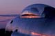 "SUNSET REFLECTED OFF CANOPY OF ""RETIRED"" T-33 JET, GRAVELBOURG"