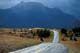 RED ROCK CANYON ROAD IN AUTUMN RAIN, WATERTON LAKES NATIONAL PARK