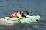 TRA AUT MIS  SK  WDS06E0974DXBRIDE AND GROOM IN 1964 AQUACAR IN SOUTH SASKATCHEWAN RIVERSASKATOON                         07© WAYNE SHIELS                ALL RIGHTS RESERVEDACTIVITIES;AQUACAR;AUTOS;CO_ED;FLAGS;OUTDOORS;PEOPLE;PLAINS;PRAIRIES;RIVERS;SASKATCHEWAN;SASKATOON;SK_;SOUTH_SASKATCHEWAN_RIVER;SUMMER;TRANSPORTATION;WATER;WEDDINGSLONE PINE PHOTO              (306) 683-0889
