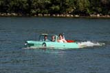 TRA AUT MIS  SK  WDS06E0994DXBRIDE AND GROOM IN 1964 AQUACAR IN SOUTH SASKATCHEWAN RIVERSASKATOON                         07© WAYNE SHIELS                ALL RIGHTS RESERVEDACTIVITIES;AQUACAR;AUTOS;CO_ED;OUTDOORS;PEOPLE;PLAINS;PRAIRIES;RIVERS;SASKATCHEWAN;SASKATOON;SK_;SOUTH_SASKATCHEWAN_RIVER;SUMMER;TRANSPORTATION;WATER;WEDDINGSLONE PINE PHOTO              (306) 683-0889