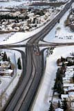 TRA ROA MIS  AB  BRH1800319D  VTFREEWAY IN WINTER FROM ABOVECALGARY                            02/02© BLAKE R. HYDE                ALL RIGHTS RESERVEDAB_;AERIAL;ALBERTA;AUTOS;CALGARY;FREEWAYS;PLAINS;PRAIRIES;ROADS;SNOW;STRUCTURES;TRAFFIC;TRANSPORTATION;URBAN;VTL;WINTERLONE PINE PHOTO              (306) 683-0889