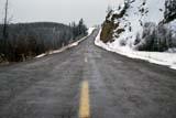 TRA ROA MIS  YT  PEH1000334DHIGHWAY IN SPRING SNOWSTORMFISH LAKE                              04© PHIL HOFFMAN                    ALL RIGHTS RESERVEDCORDILLERA;FISH_LAKE;HIGHWAYS;ROADS;SCENES;SNOW;SPRING;TRANSPORTATION;YT_;YUKONLONE PINE PHOTO              (306) 683-0889