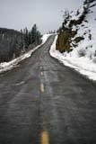 TRA ROA MIS  YT  PEH1000336D  VTHIGHWAY IN SPRING SNOWSTORMFISH LAKE                              04© PHIL HOFFMAN                    ALL RIGHTS RESERVEDCORDILLERA;FISH_LAKE;HIGHWAYS;ROADS;SCENES;SNOW;SPRING;TRANSPORTATION;VTL;YT_;YUKONLONE PINE PHOTO              (306) 683-0889