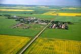 AER SUM SCE  SK     1804211D      AERIAL VIEW OF PRAIRIE TOWN AND ROAD THROUGH SUMMER FIELDSABERDEEN                           07/10© CLARENCE W. NORRIS      ALL RIGHTS RESERVEDABERDEEN;AERIAL;CANOLA;CROPS;FARMING;PATTERNS;PLAINS;PRAIRIES;ROADS;SCENES;SASKATCHEWAN;SK_;SLOUGHS;SUMMER;TOWNSLONE PINE PHOTO              (306) 683-0889