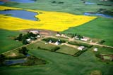 AER SUM SCE  SK     1804304D     AERIAL VIEW OF PRAIRIE TOWN IN SUMMERST. DENIS                                07/10© CLARENCE W. NORRIS          ALL RIGHTS RESERVEDAERIAL;CANOLA;CHURCHES;CROPS;FARMING;FIELDS;PLAINS;PRAIRIES;ROADS;RURAL;SASKATCHEWAN;SCENES;SK_;SLOUGHS;ST._DENIS;SUMMER;TOWNSLONE PINE PHOTO                  (306) 683-0889
