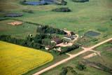 AER SUM SCE  SK     1804309DAERIAL VIEW OF CHAMPETRE FARM IN SUMMERST. DENIS                           07/10© CLARENCE W. NORRIS     ALL RIGHTS RESERVEDAERIAL;DUGOUTS;FARMING;HOMES;PLAINS;PRAIRIES;ROADS;RURAL;SASKATCHEWAN;SCENES;SK_;ST._DENIS;SUMMERLONE PINE PHOTO              (306) 683-0889