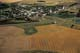 AERIAL VIEW OF TOWN AND FIELD PATTERNS IN AUTUMN, ROSTHERN