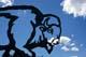 BUFFALO SCULPTURE AGAINST SUMMER SKY, WINNIPEG