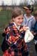 GIRL HOLDING BAG CONTAINING BANDED BIRD, LAST MOUNTAIN LAKE