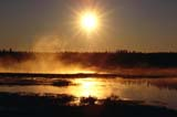 CAL AUT SCE  MB  BAE1000072DSUNRISE THROUGH MORNING MIST ON LAKETHOMPSON               09..© BRUCE A. ECKER     ALL RIGHTS RESERVEDAUTUMN;BOREAL;CAL_MB;CALENDARS;FLARE;LAKES;MANITOBA;MB_;MIST;SCENES;SHIELD;SUN;SUNRISE;THOMPSON;WATERLONE PINE PHOTO    (306) 683-0889