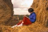 CAL FAR MIS  SK     1616726D               MR #287-288GIRL READING BOOK ON ROUND BALESLANGHAM                                0921© CLARENCE W. NORRIS           ALL RIGHTS RESERVEDAUTUMN;BALES;CAL_FARMING;CALENDARS;FARMING;FEMALE;LANGHAM;MR_;OUTDOORS;PEOPLE;READING;RURAL;SASKATCHEWAN;SCENES;SK_;TAMARA;TEENS;WESTERNLONE PINE PHOTO                   (306) 683-0889