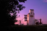 CAL FAR MIS SK     1703506DSASK WHEAT POOL ELEVATORS AT SUNSETWAKAW                              0715© CLARENCE W. NORRIS      ALL RIGHTS RESERVEDBUILDINGS;CAL_FARMING;CALENDARS;ELEVATORS;FARMING;PLAINS;POOL;PRAIRIES;RURAL;SASK_WHEAT_POOL;SASKATCHEWAN;SCENES;SK_;STRUCTURES;SUMMER;SUNSETS;WAKAWLONE PINE PHOTO              (306) 683-0889