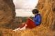 GIRL READING BOOK ON ROUND BALES, LANGHAM