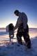 MAN AT COUNTRY MAILBOX AND WINTER SUN STAR, SASKATOON