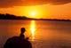 BOY FISHING AT SUNSET, GRAND BEACH PROVINCIAL PARK