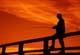 FISHERMAN AGAINST SUNSET SKY, JACKFISH LAKE, AQUEDEO BEACH