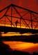 FISHERMAN ON STEEL BRIDGE AT SUNSET, EAGLE CREEK REGIONAL PARK