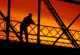 FISHERMAN ON STEEL BRIDGE AT SUNSET, EAGLE CREEK REGIONAL PK