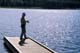MAN CASTING OFF DOCK, PARR HILL LAKE