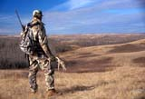 CAL HUN MIS  AB  DSR1000126D  MR    DEER HUNTER OVERLOOKING THE BATTLE RIVER BREAKSCENTRAL ALBERTA             11/..© DUANE S. RADFORD      ALL RIGHTS RESERVEDAB_;ALBERTA;ANTLERS;AUTUMN;CAL_HUNTING;CALENDARS;CAMOUFLAGE;FIELDS;GUNS;HUNTING;MALE;OUTDOORS;PEOPLE;PLAINS;PRAIRIES;SCENESLONE PINE PHOTO              (306) 683-0889