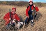 CAL HUN MIS  AB  DSR1000128D  MR     PHEASANT HUNTERS WITH A FINE COCK PHEASANTCENTRAL ALBERTA           10/..© DUANE S. RADFORD      ALL RIGHTS RESERVEDAB_;ACTIVITIES;ADULTS;ALBERTA;ANIMALS;AUTUMN;BOY;CAL_HUNTING;CALENDARS;COUPLE;DOGS;GAME;GUNS;HUNTING;MALE;MR_;OUTDOORS;PEOPLE;PETS;PHEASANTS;PLAINS;PRAIRIES;SCENES;SMALL LONE PINE PHOTO              (306) 683-0889