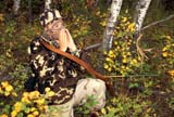 CAL HUN MIS  SK     1616922D  MR#287-288MAN IN CAMOUFLAGERECURVE BOW IN FALL ASPENSLANGHAM                            0921© CLARENCE W. NORRIS      ALL RIGHTS RESERVEDACTIVITIES;ADULTS;ARCHERY;ARROWS;ASPENS;AUTUMN;BOWS;CAL_HUNTING;CALENDARS;CAMOUFLAGE;FOREST;HUNTING;LANGHAM;MALE;MR_;OUTDOORS;PEOPLE;SASKATCHEWAN;SCENES;SK_;TREES;WEAPONSLONE PINE PHOTO              (306) 683-0889
