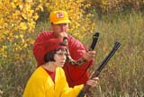 CAL HUN MIS  SK     1616323D  MR#287-288MAN AND DAUGHTER, .30-.30 RIFLE, BUGLING FOR ELKLANGHAM                            0921© CLARENCE W. NORRIS      ALL RIGHTS RESERVEDACTIVITIES;ADULTS;AUTUMN;BUGLING;CAL_HUNTING;CALENDARS;CO_ED;COUPLE;DOUGLAS;FAMILIES;FEMALE;FOREST;GUNS;HUNTING;LANGHAM;MALE;MR_;OUTDOORS;PEOPLE;PLAINS;PRAIRIES;RIFLES;SASKATCHEWAN;SK_;TAMARA;TEENS;WEAPONSLONE PINE PHOTO              (306) 683-0889