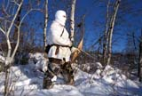 CAL HUN MIS  SK     1618819D MR#290 MAN WITH RE-CURVE BOW HUNTING IN WINTERSASKATOON                       127© CLARENCE W. NORRIS      ALL RIGHTS RESERVEDACTIVITIES;ADULTS;ARCHERY;BOWS;CAL_HUNTING;CALENDARS;CAMOUFLAGE;FOREST;HUNTING;MALE;MR_;OUTDOORS;PEOPLE;PLAINS;PRAIRIES;SASKATCHEWAN;SASKATOON;SCENES;SK_;SNOW;TREES;WEAPONS;WINTERLONE PINE PHOTO              (306) 683-0889