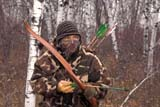 CAL HUN MIS  SK     1618211D MR#289 HUNTER WITH RECURVE BOW IN CAMO IN AUTUMN ASPENS SASKATOON                       1019© CLARENCE W. NORRIS      ALL RIGHTS RESERVEDACTIVITIES;ADULTS;ARCHERY;ARROWS;ASPENS;AUTUMN;BOWS;CAL_HUNTING;CALENDARS;CAMOUFLAGE;DOUGLAS;FOREST;HUNTING;MALE;MR_;OUTDOORS;PEOPLE;PLAINS;PRAIRIES;SASKATCHEWAN;SASKATOON;SCENES;SK_;WEAPONS;LONE PINE PHOTO              (306) 683-0889