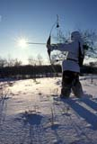 CAL HUN MIS  SK     1619124D  MR290  VT  RECURVE BOW HUNTER AND WINTER SUN STARSASKATOON                       12/07© CLARENCE W. NORRIS      ALL RIGHTS RESERVEDACTIVITIES;ADULTS;ARCHERY;ARROWS;BOWS;CAL_HUNTING;CALENDARS;CAMOUFLAGE;FOREST;HUNTING;MALE;MR_;OUTDOORS;PEOPLE;PLAINS;PRAIRIES;SASKATCHEWAN;SASKATOON;SCENES;SK_;SNOW;SUNSTARS;VTL;WEAPONS;WINTERLONE PINE PHOTO              (306) 683-0889