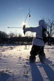CAL HUN MIS  SK     1619125D  MR290  VT  RECURVE BOW HUNTER AND WINTER SUN STARSASKATOON                       12/07© CLARENCE W. NORRIS      ALL RIGHTS RESERVEDACTIVITIES;ADULTS;ARCHERY;ARROWS;BOWS;CAL_HUNTING;CALENDARS;CAMOUFLAGE;HUNTING;MALE;MR_;OUTDOORS;PEOPLE;PLAINS;PRAIRIES;SASKATCHEWAN;SASKATOON;SCENES;SK_;SNOW;SUNSTARS;VTL;WEAPONS;WINTERLONE PINE PHOTO              (306) 683-0889