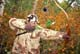 MAN IN CAMOUFLAGE HUNTING WITH RECURVE BOW, LANGHAM