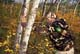 MAN IN CAMOUFLAGE RECURVE BOW IN FALL ASPENS, LANGHAM