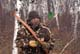 HUNTER WITH RECURVE BOW IN CAMO IN AUTUMN ASPENS, SASKATOON
