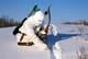 RECURVE BOW HUNTER CHECKING GAME TRAIL IN SNOW, SASKATOON