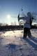 RECURVE BOW HUNTER AND WINTER SUN STAR, SASKATOON
