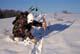 RECURVE BOW HUNTER CHECKING GAME TRAIL IN WINTER, SASKATOON