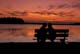 COUPLE ON BENCH AT TWILIGHT, ELK ISLAND NATIONAL PARK