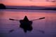 WOMAN IN ROWBOAT AT TWILIGHT, ASTOTIN LAKE, ELK ISLAND NATIONAL PARK