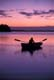 LADY IN ROWBOAT AT TWILIGHT, ASTOTIN LAKE, ELK ISLAND NATIONAL PARK