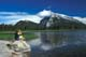 WOMAN WITH BINOCULARS GAZING AT MT. RUNDLE, BANFF NATIONAL PARK